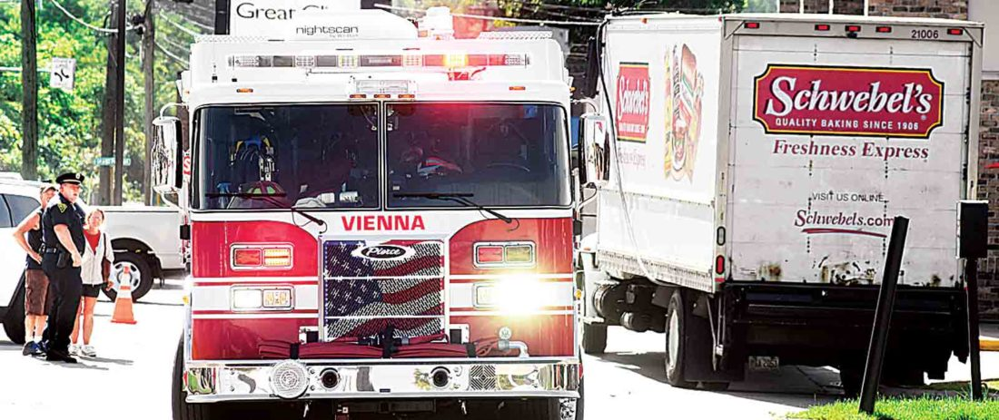 A truck from the Vienna Volunteer Fire Department sits at the scene of a downed utility line on Monday between Burger King and Firehouse Subs. A bread delivery truck hit a utility pole and power was out to the traffic lights in front of Grand Central Mall. (Photo by Jeff Baughan)