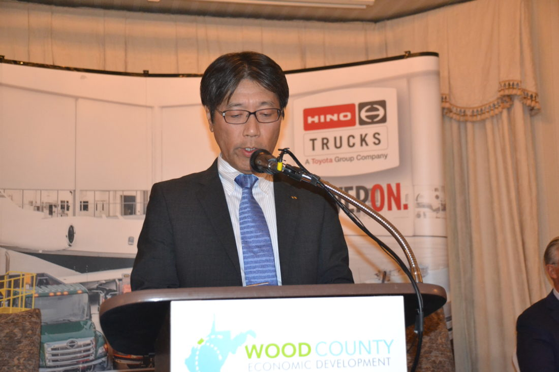 Takashi Ono, president Hino Motors, speaks during a press conference Wednesday at the Parkersburg Country Club in Vienna where he said the company will expand into the former Coldwater Creek building at the business park in Parkersburg. The $100 million project will create 250 new jobs, he said.