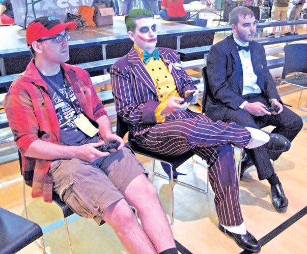 File Photo Playing a video game at last year's Parkersburg Pop Con were, from left, Dakota Delong, Austin Foster and Greg Cochran, all of Parkersburg.
