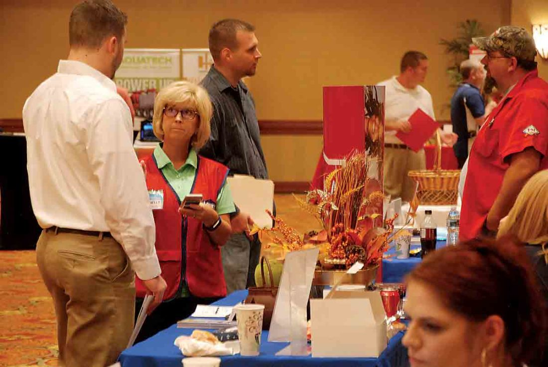 Photo by Art Smith Vienna Lowe's employee Janelle Cheuvront talks with a person attending The Parkersburg News and Sentinel Job Fair Friday at the Grand Pointe Conference Center in Vienna.