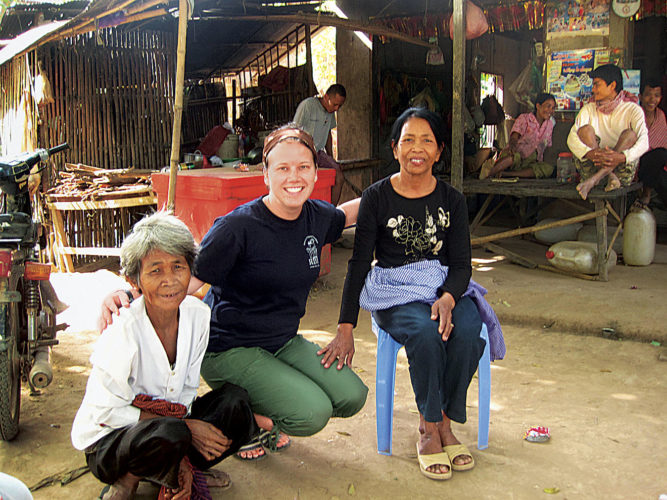 Photo Provided Lori Frees with a pair of Cambodian villagers.
