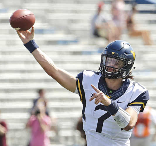 West Virginia quarterback Will Grier (7) passes the ball during the second half of an NCAA college football game last Saturday against Kansas in Lawrence, Kan. West Virginia won 56-34.