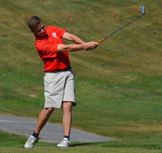 Photo by Cody Tomer Parkersburg's Isaac Prine hits a shot during high school golf state tournament action Tuesday at the Jones Course in Wheeling.