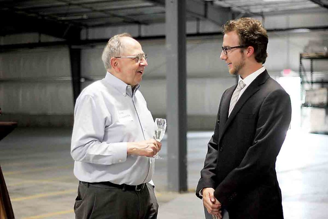 Photo by Janelle Patterson Bob Kirkbride, left, talks with Noah Hukill, right, about the need for warehouse space for local businesses at the opening of Keystone Warehousing in Marietta.