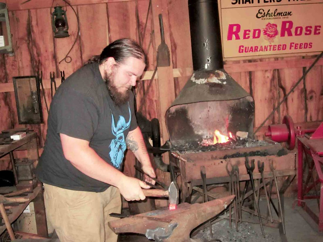 File Photo Caleb Givens, of Belpre, gives a blacksmithing demonstration during last year's Belpre Heritage Day at the Farmers Castle Museum Education Center in Belpre. This year's event will be 11 a.m. to 4 p.m. Saturday.