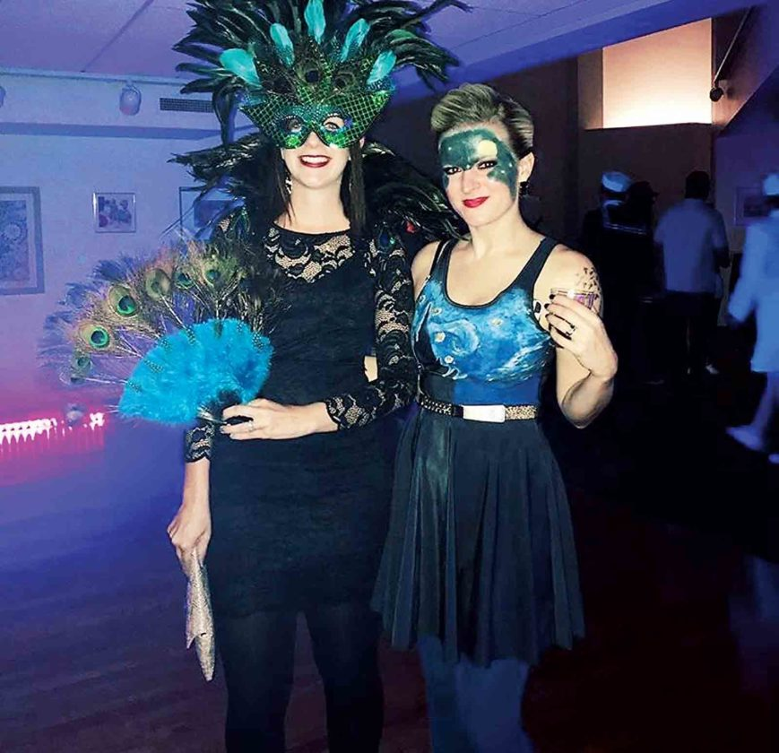 "Photo Provided Nicole Harris and Courtney Smith as a peacock and Van Gogh's Starry Night at last year's ""MasqueRave."""