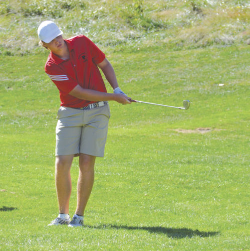 Ravenswood's Carson Fox hits a shot during Wednesday's Class A state championship golf tournament at Oglebay Resort's Jones Course. Fox earned all-state honors by finishing third overall and helped the Red Devils win the school's second state golf crown. Photo by Cody Tomer.