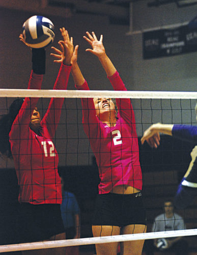 Ohio Valley University's Stephany Orjuela (12) and Dana Lichtendonk (2) go up for a double block during Thursday's match inside the Snyder Activity Center against Trevecca Nazarene University. The Trojans defeated the Fighting Scots in five sets. Photo by Jay W. Bennett.
