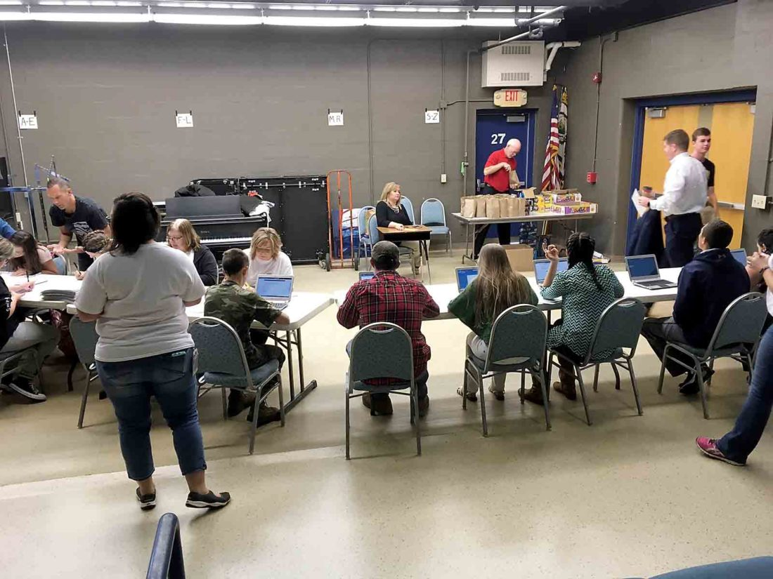 Photo Provided Parkersburg Rotarians and 11 Dow-DuPont employees teamed up to assist Parkersburg South High School students on the first test day in the voluntary Drug Free Schools of America project on Sept. 26.