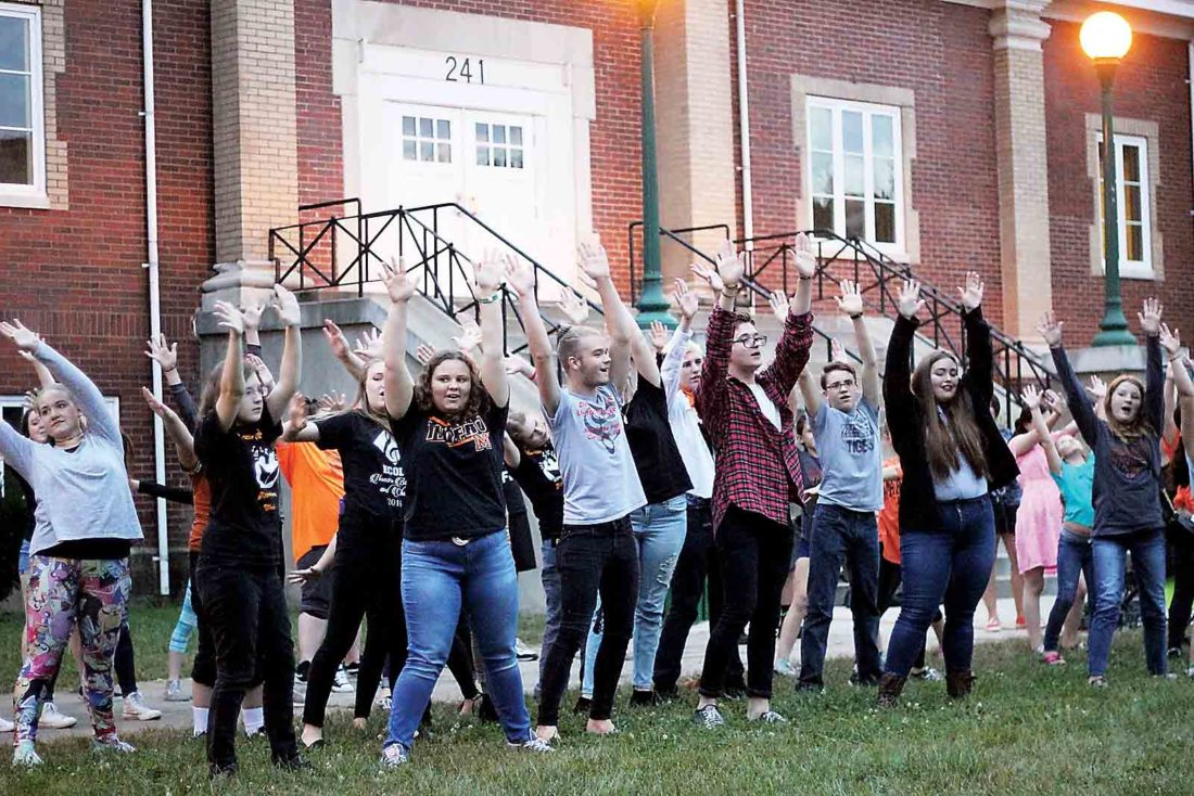 "Photo by Janelle Patterson Marietta High School and Marietta Middle School choir students perform a choreographed flash mob to Smash Mouth's version of  ""I'm a Believer"" during Marietta Main Street's First Fridays festivities."