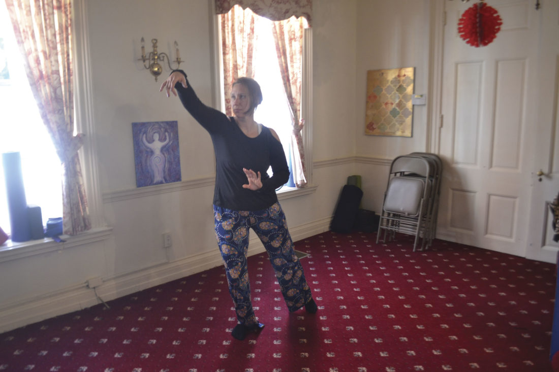 Photo by Michael Kelly Cat Bigley, fitness instructor at the Betsey Mills Club, practices tai chi in a room at the club after a noon-hour class.