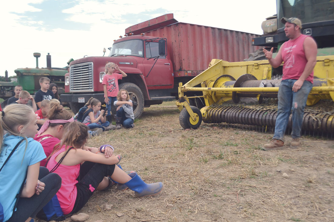 Photo by Michael Kelly Les Schramm talks to a group of Warren and Frontier school district fifth-graders about crop agriculture Friday at the Schramm Farm near Reno.