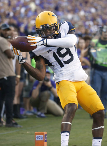 West Virginia cornerback Elijah Battle (19) juggles a would be interception as West Virginia plays TCU during the second half of an NCAA college football game Saturday, Oct. 7, 2017, in Fort Worth, Texas. TCU won 31-24. The play was ruled an incompletion. (AP Photo/Ron Jenkins)