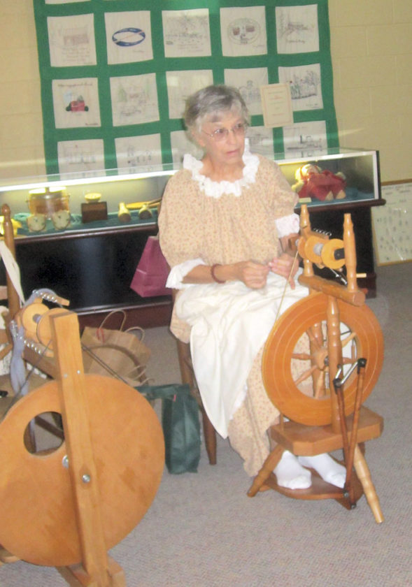 Photo by Wayne Towner Joan Coffey, a member of the Belpre Historical Society, demonstrates spinning on Saturday during Belpre Heritage Day.