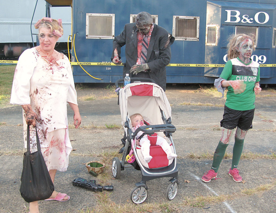 Photo by Jeffrey Saulton Getting ready for the Zombie Fest were, from left, Lisa Robinson, Chris Brown, Ellie Brown and Lexi Brown, all of Marietta.