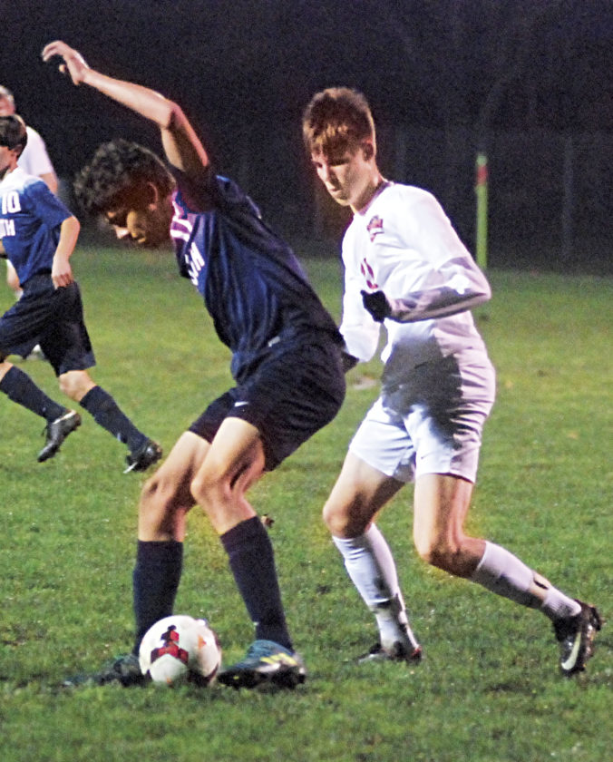 Photo by Jordan Holland Parkersburg South's Ben Haught (11) battles Marietta's Ryan Mannix (12) for possession of the ball during a high school boys soccer match Thursday at Jerry Brock Field in Devola, Ohio. Marietta won, 6-0.
