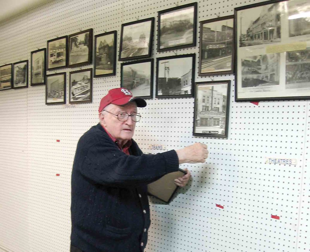 Photo courtesy of Bob Enoch Earlier this month, Artcraft Studio owner Paul Borrelli takes a photo down from the wall of the business his father opened in 1925. The walls that were once filled with photographs but are now bare white as Borrelli cleans out the business.