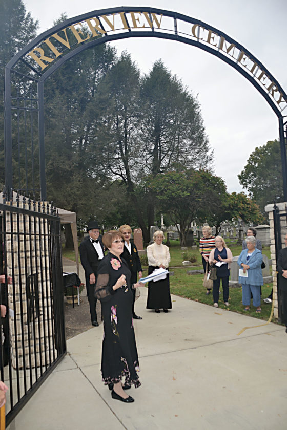 Photo by Brett Dunlap Judith Smith, of the Julia-Ann Square Historical Community Association, presided over the dedication Sunday of a new fence that surrounds Riverview Cemetery on Juliana Street.