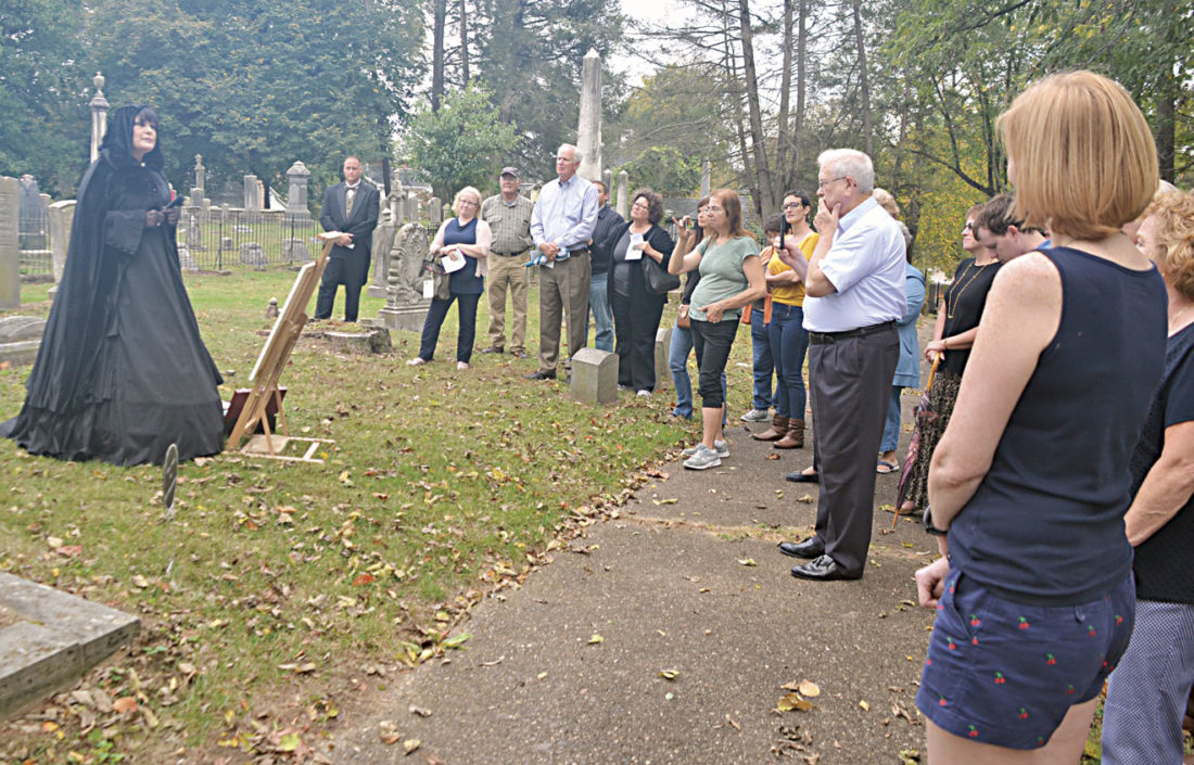 Photo by Brett Dunlap As part of the dedication of the new fence for Riverview Cemetery, a number of local re-enactors portrayed famous local residents who are buried in the cemetery. Kelleyn McClain portrayed Lily Irene Jackson, who is buried in the plot where the famed statue of the weeping woman is located.