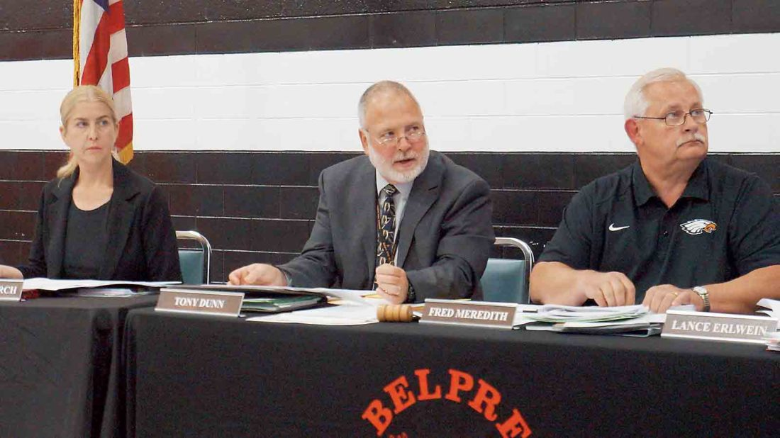 Belpre City Schools Board of Education member Brenda Church, left, Superintendent Tony Dunn, center, and board President Fred Meredith, right, look at a presentation on state test scores during Monday's board of education meeting. (Photo by Michael Erb)