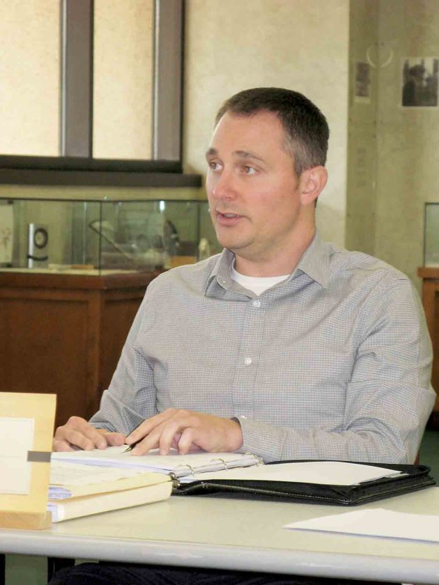 Parkersburg Finance Director Eric Jiles discusses a proposed budget revision during Tuesday's City Council Finance Committee meeting at the Municipal Building. (Photo by Evan Bevins)