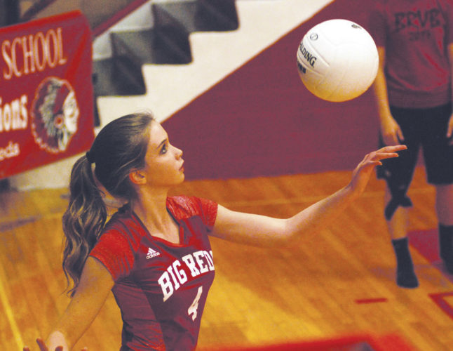 Parkersburg's Lindsey Kiger prepares to serve the ball during Wednesday's home triangular inside Memorial Fieldhouse. Kiger and fellow teammate Amayah Lauer were honored prior to the quad on senior night for the Big Reds, who went 3-0. Photo by Jay W. Bennett.