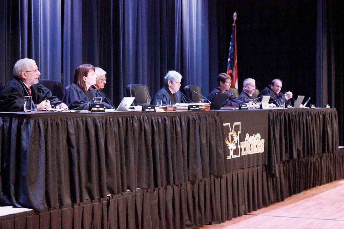 Photo by Janelle Patterson The Ohio Supreme Court sits on the stage of the Marietta High School Auditorium Wednesday in an off-site session viewed in person by local students from Washington County.
