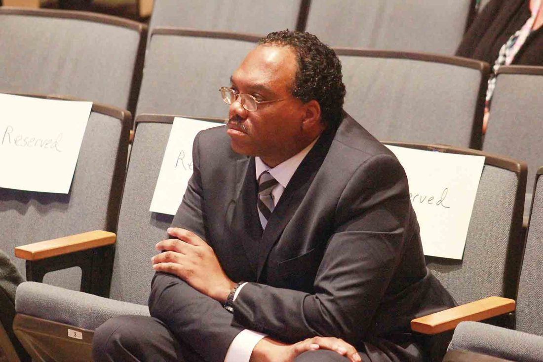 Photo by Janelle Patterson Former Cuyahoga Common Pleas Judge Lance Mason sits in the front row of the Marietta High School Auditorium listening to arguments before the Ohio Supreme Court about his possible disbarment for assaulting his wife in 2014.