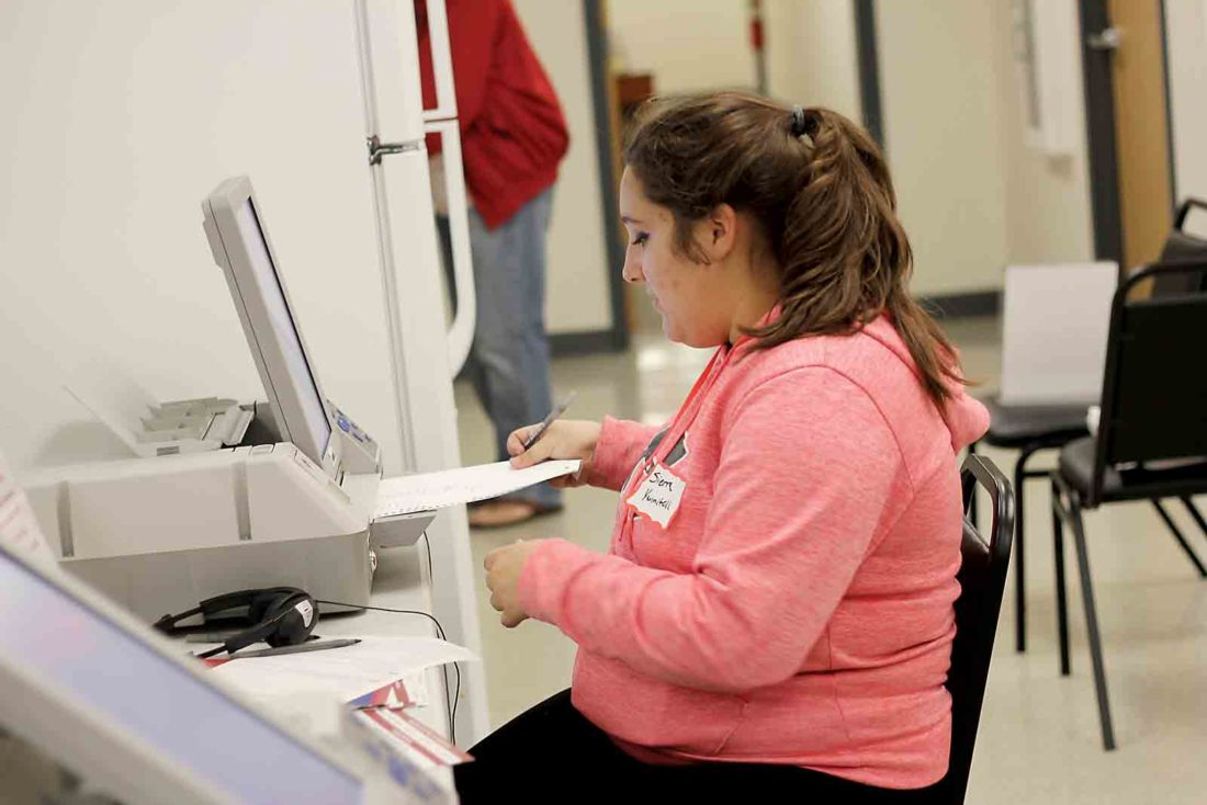 Photo by Janelle Patterson Sierra Tannitell practices using the electronic polling station available for those with hearing and sight impairments during poll worker training Wednesday at the Washington County Board of Elections.
