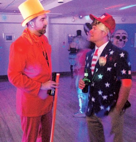 "File Photo Mark McLean, left, came as Charlie Christmas from ""Dumb and Dumber"" and Philip Wilt, right, came as Donald Trump at last year's MasqueRave. This year's event will be Friday evening at the Parkersburg Art Center at Eighth and Market streets in downtown Parkersburg."