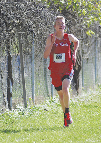Parkersburg High School senior Ian Domenick had a dominating performance at Thursday's Class AAA, Region IV meet in Mineral Wells. The Big Red crossed the finish line with a winning effort of 16 minutes and 11 seconds. PHS was the regional runner-up and will join the red and white girls, who won the regional title, at next week's state meet. Photo by Jay W. Bennett.