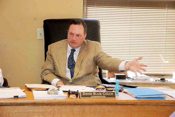 Photo by Evan Bevins Wood County Commission President Blair Couch discusses potential consolidation of public service districts during the commission's meeting Thursday.