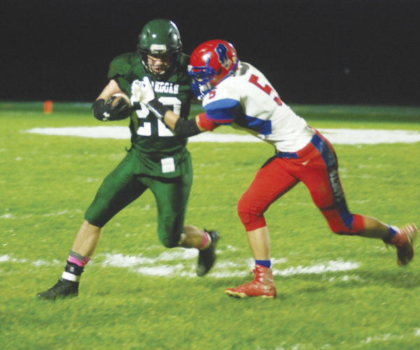 Shenandoah's Nick Miller (22) tries to avoid getting tackled by Fort Frye's Caden Fryman during a high school football game Friday night in Sarahsville, Ohio. Fort Frye won, 26-8. Photo by Mike Morrison.