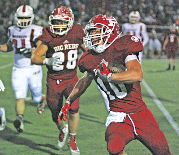 Parkersburg's Jake Johnson, pictured here looking for running room during the Big Reds' 35-7 victory Friday night against Hurricane inside Stadium Field, returned the second-half kickoff 87 yards, which set up teammate Tyler Moler's 3-yard touchdown run. Photo by Jay W. Bennett.