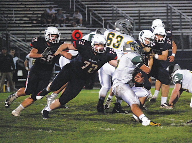 Parkersburg South's Kory Williams (72) tackles Greenbrier East's Jacob Thomas in the host Patriots' 29-12 win Friday night at Erickson All-Sports Facility. Photo by Steve Hemmelgarn.