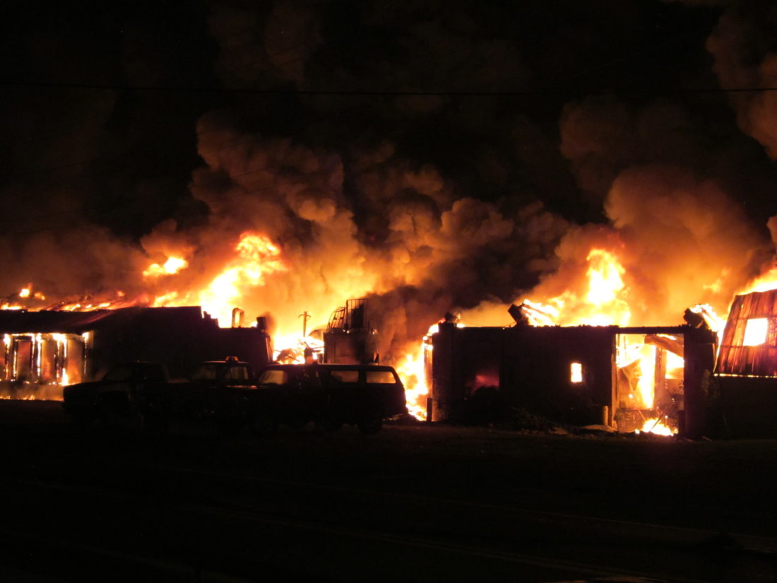 Photo by Jess Mancini Flames rose several hundred feet in the air at a fire at the old Ames Plant on Camden Avenue at around 2 a.m.