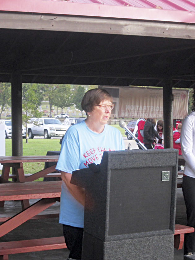 Photo by Wayne Towner Heart attack survivor Monica Davis, of Parkersburg, was this year's honoree at the 2017 Mid-Ohio Valley Heart and Stroke Walk at City Park. Davis was the top individual walker by collecting $1,840 for the event.