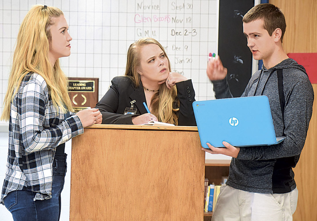 Photo by Jeff Baughan Madison Suszek, left, listens to Brendin Flinn, right, argue his point. Parkersburg South High School Debate coach Michelle Talbott, center, takes notes from the rehearsal.