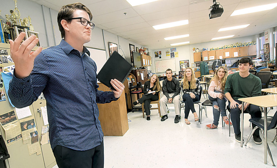 Photo by Jeff Baughan Ethan Schaffer rehearses an oral interpretation in front of the Parkersburg South travel team. From left, Coach Michelle Talbott,  Brendin Flinn, Madison Suszek, Emily Marlow and Cole Dickson. Marlow is soon to move up to the travel team, according to Talbott.