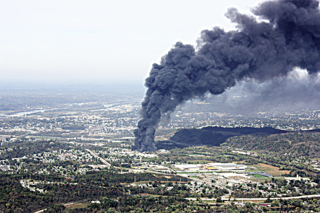 Photo courtesy of Ray Hollen An aerial view of the Ames Plant fire taken Saturday by local pilot Ray Hollen. The smoke plume stretched for miles to the north and west of its source on Old Camden Avenue in south Parkersburg. Firefighting efforts continued Sunday and are expected to last for several days.