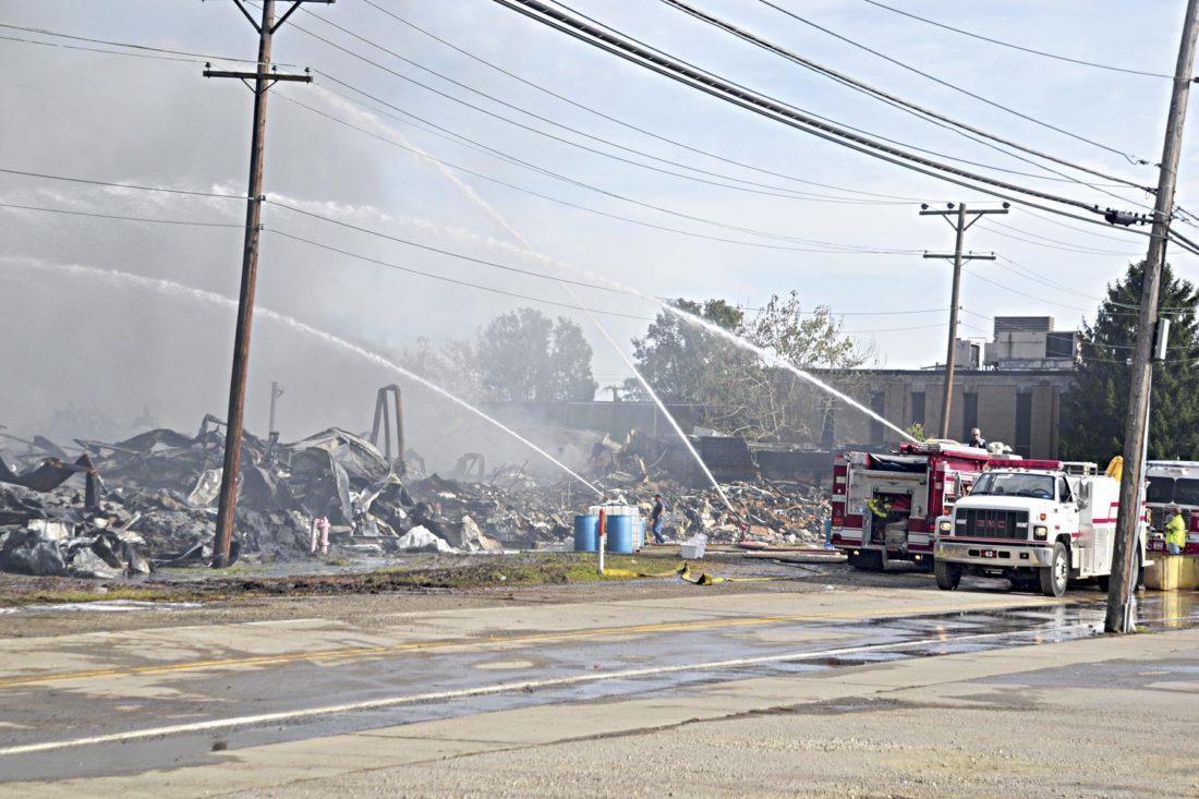 Photo by Brett Dunlap In fighting the fire at the former Ames plant in south Parkersburg, firefighters' efforts have primarily involved spraying water on different sections of the property.
