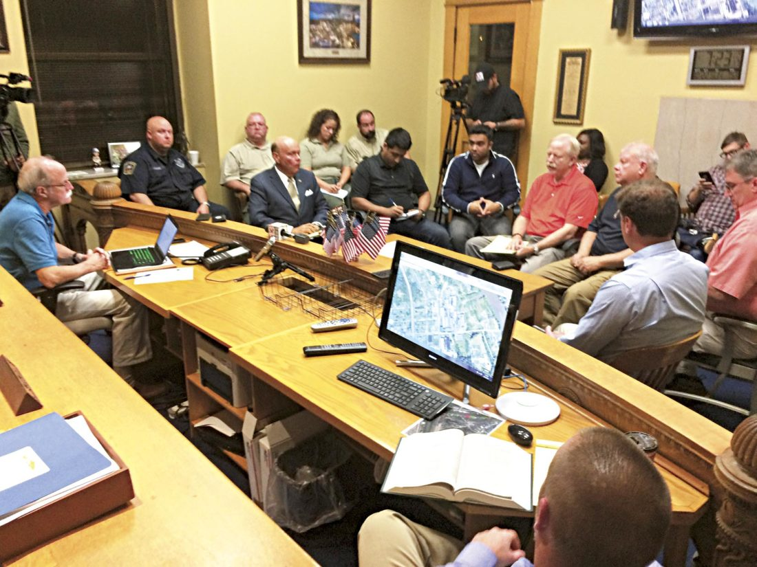 Photo by Brett Dunlap The Wood County Commission held an emergency meeting Sunday evening with emergency officials to discuss the fire situation at the former Ames plant in south Parkersburg.