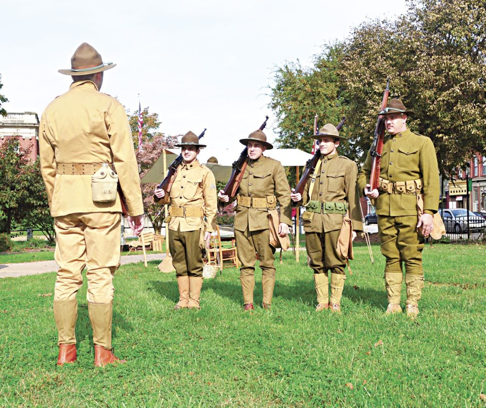 Photo by Doug Loyer Cyrus Moore of the Southern Ohio History Center leads these World War I re-enactors through drills.