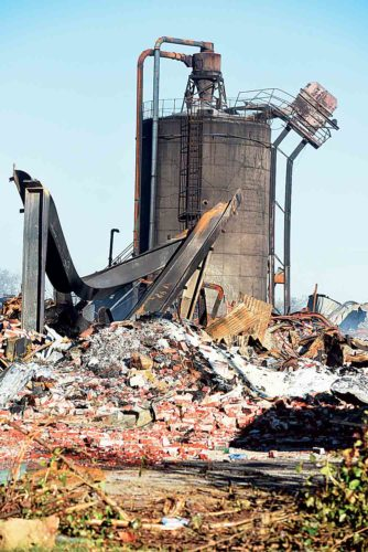 Twisted and scorched metal sits among the ruins of the former Ames Plant Friday morning as mostly clear skies marked the end of the week since the disaster. (Photo by Jeff Baughan)