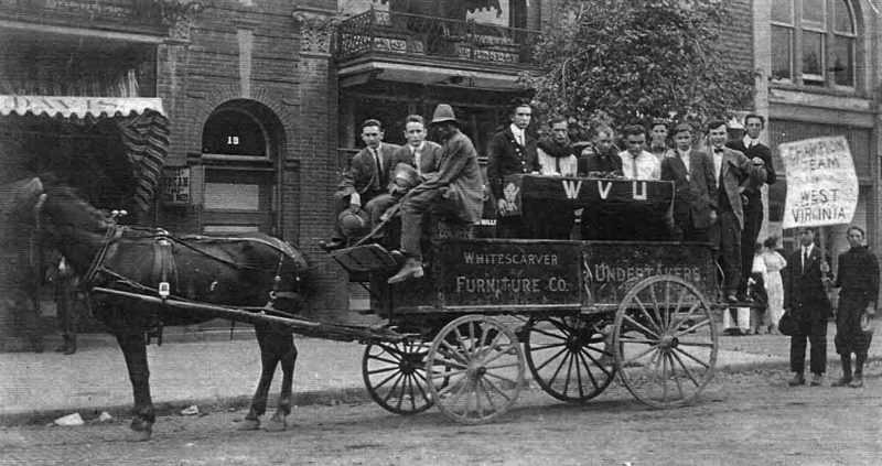 The undated photo above shows what may be the Marietta College football team, on the streets of Marietta, spoofing the West Virginia football team they were about to play. The Whitescarver Furniture Co. — Undertakers wagon appears to be hauling a coffin with WVU painted on the lid.  The teams began annual games in the mid-1890s. (Photo Provided)