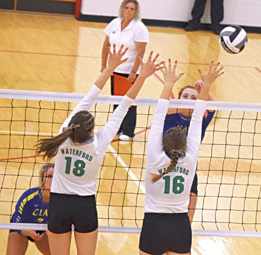Waterford's Megan Ball (18) and Denise Young (16) go up for a block during a district final volleyball match against Portsmouth Clay Saturday at Jackson High School in Jackson, Ohio. Photo by Kevin Colley