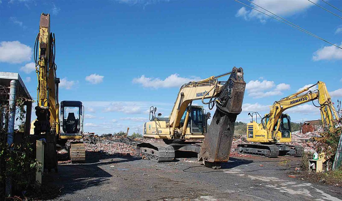 A trio of track hoes used to fight the Old Camden Avenue fire are lined up along the edge of the debris Tuesday caused by the former Ames plant fire than burned for more than a week. (Photo by Art Smith)