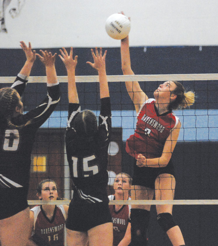 Ravenswood's Skylar Mace goes for the kill as Williamstown's Brittney Hooper forms part of a double block during sectional volleyball action Thursday evening at Parkersburg Catholic. Photo by Jay W. Bennett.