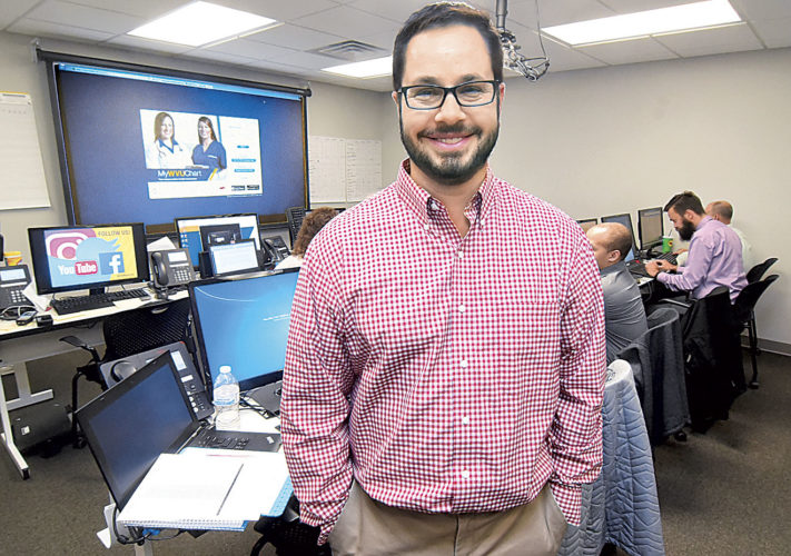Photo by Jeff Baughan Josh Woods, the Camden Clark Medical Center's Information Technology Site administrator, stands in one of three rooms which make up the command center for its connection with the MyWVUChart, the online patient portal for WVU Medicine. MyWVUChart replaces FollowMyHealth as of Wednesday.