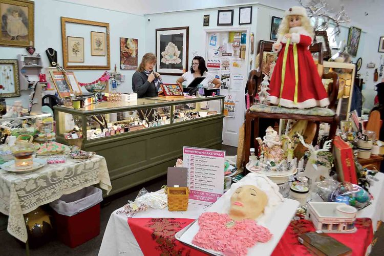 Photo by Michael Kelly A likeness of Marie Antoinette in cake sits in the center of Green Acres on Front Street as shoppers browse the stores during the First Fridays event.